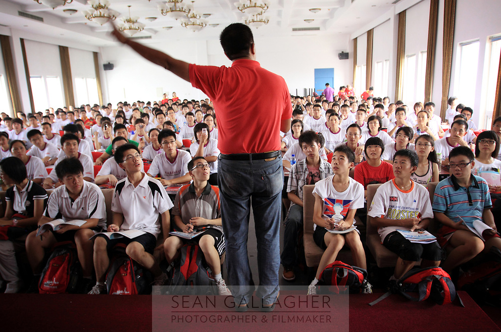 CHINA. Chinese students learning English at the Li Yang 'Crazy English' school in Beijing. The school is famous for having hundreds of students chanting English together during classes. 2009