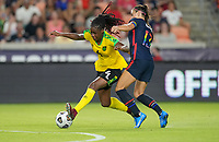 HOUSTON, TX - JUNE 13: Alex Morgan #13 of the United States enters the game and immediately applies the heat to Deneisha Blackwood #14 of Jamaica during a game between Jamaica and USWNT at BBVA Stadium on June 13, 2021 in Houston, Texas.