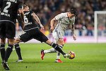 James Rodriguez (r) of Real Madrid fights for the ball with Raul Albentosa Redal of RC Deportivo La Coruna during the La Liga match between Real Madrid and RC Deportivo La Coruna at the Santiago Bernabeu Stadium on 10 December 2016 in Madrid, Spain. Photo by Diego Gonzalez Souto / Power Sport Images