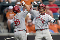 Designated hitter Evan Mistich #9 of the Oklahoma Sooners celebrates scoring against the Texas Longhorns with teammate Tyler Ogle #35 in NCAA Big XII baseball on May 1, 2011 at Disch Falk Field in Austin, Texas. (Photo by Andrew Woolley / Four Seam Images)