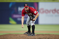 Carolina Mudcats relief pitcher Kent Hasler (24) looks to his catcher for the sign against the Kannapolis Cannon Ballers at Atrium Health Ballpark on June 9, 2021 in Kannapolis, North Carolina. (Brian Westerholt/Four Seam Images)