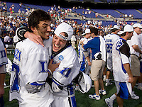 Jake Tripucka (27) and Eddie Loftus (41) celebrates after the NCAA Men's Lacrosse Championship held at M&T Stadium in Baltimore, MD.  Duke defeated Notre Dame, 6-5, to win the title in overtime.