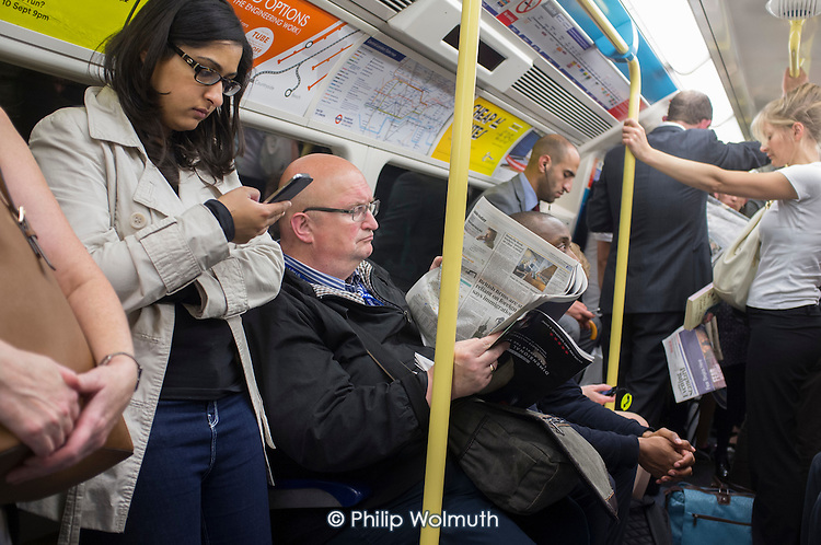 Crowded Jubilee Line carriage at rush hour London.