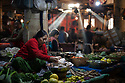 India - Manipur - Imphal - A vegetable seller organizes her stall during the day.