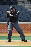 Home plate umpire Jamie Roebuck makes a strike call during the NCAA baseball game between the Marshall Thundering Herd and the Wake Forest Demon Deacons at Wake Forest Baseball Park on February 17, 2014 in Winston-Salem, North Carolina.  The Demon Deacons defeated the Thundering Herd 4-3.  (Brian Westerholt/Four Seam Images)