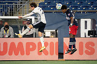FOXBOROUGH, MA - OCTOBER 19: DeJuan Jones #24 of New England Revolution heads the ball during a game between Philadelphia Union and New England Revolution at Gillette on October 19, 2020 in Foxborough, Massachusetts.