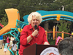 Spark School Park Program Executive Director Kathleen Ownby thanks numerous people for their help on the Dragon and Phoenix Spark Park dedication ceremony at Mandarin Immersion Magnet School on Oct. 27, 2017.