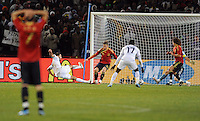 David Villa of Spain watches on dejected as Clint Dempsey of USA scores his side's second goal. USA defeated Spain 2-0 during the semi-finals of the FIFA Confederations Cup at Free State Stadium in Manguang/Bloemfontein, South Africa on June 24, 2009..