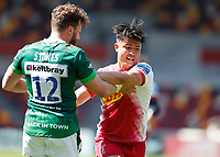 24th April 2021; Brentford Community Stadium, London, England; Gallagher Premiership Rugby, London Irish versus Harlequins; James Stokes of London Irish tussles with Marcus Smith of Harlequins