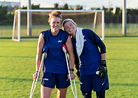 KASHIMA, JAPAN - AUGUST 4: Alyssa Naeher #1 and Jane Campbell #22 of the USWNT pose for a photo after a training session at the practice field on August 4, 2021 in Kashima, Japan.