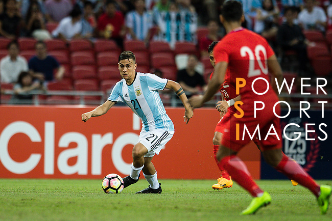 Paulo Dybala of Argentina (L) in action during the International Test match between Argentina and Singapore at National Stadium on June 13, 2017 in Singapore. Photo by Marcio Rodrigo Machado / Power Sport Images