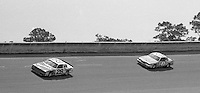 Richard Petty and Cale Yardborough battle for the lead en route to Petty's 200th win in Firecracker 400 at Daytona International Speedway in Daytona beach, FL on July 4m 1984.  (Photo by Brian Cleary/www.bcpix.com)