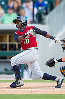 Adonis Garcia (10) of the Scranton/Wilkes-Barre RailRiders follows through on his swing against the Charlotte Knights at BB&T Ballpark on July 17, 2014 in Charlotte, North Carolina.  The Knights defeated the RailRiders 9-5.  (Brian Westerholt/Four Seam Images)