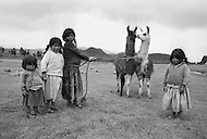 In Bolivia, children are employed as shepherds on the Altiplano plateau. - Child labor as seen around the world between 1979 and 1980 – Photographer Jean Pierre Laffont, touched by the suffering of child workers, chronicled their plight in 12 countries over the course of one year.  Laffont was awarded The World Press Award and Madeline Ross Award among many others for his work.