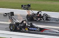 Apr. 28, 2013; Baytown, TX, USA: NHRA top fuel dragster driver Bob Vandergriff Jr (far lane) races alongside Larry Dixon during the Spring Nationals at Royal Purple Raceway. Mandatory Credit: Mark J. Rebilas-