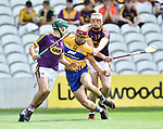 John Conlon of Clare in action against Liam Ryan and Shaun Murphy of Wexford during their All-Ireland quarter final at Pairc Ui Chaoimh. Photograph by John Kelly.