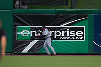 Lakeland Flying Tigers Brock Deatherage (14) crashes into the outfield wall attempting to catch a fly ball during a Florida State League game against the Clearwater Threshers on May 14, 2019 at Spectrum Field in Clearwater, Florida.  Clearwater defeated Lakeland 6-3.  (Mike Janes/Four Seam Images)
