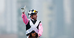 HONG KONG - DECEMBER 12:  Gerald Mosse of France riding Hong Kong's Beauty Flash wins the Hong Kong Mile during the Cathay Pacific International Races at the Sha Tin Racecourse on December 12, 2010 in Hong Kong, Hong Kong. Photo by Victor Fraile / The Power of Sport Images