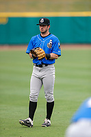 Biloxi Shuckers second baseman Tyler Friis (20) warms up prior to the game against the Tennessee Smokies on May 18, 2021, at Smokies Stadium in Kodak, Tennessee. (Danny Parker/Four Seam Images)