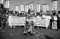 Victims of Rana Plaza collapse and their relatives demonstrate for compensation at the disaster site (Rana Plaza) in Savar, near Dhaka, Bangladesh