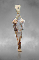 Female Cycladic statue figurine with folded arms of the Spedos and Dokathismata type. Early Cycladic Period II (2800-3200) from Amorgos. National Archaeological Museum, Athens.   Grey background.<br /> <br /> <br /> This Cycladic statue figurine is of the Spedos type standing on tip tie with bended knees and arms folded under the breasts with head raiised. This staue belongs to the Dokathismata type of Amorgos with an angular face, wide chest and slender outline.