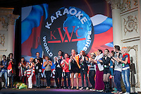 """Moscow, Russia, 25/09/2010..Contestants perform """"We Are The World"""" at the end of the Karaoke World Championships 2010, where amateur singers from around the world competed for prizes that included one million Russian dumplings."""