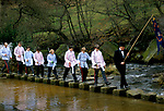 Goathland Plough Stots Goathland Yorkshire UK. 1980s  Members of the Stots cross the Murk Esk a tributary of the River Esk at Darnholm. 1980s UK
