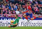 Antoine Griezmann of Atletico de Madrid (R) in action as he fights for the ball with Victor Laguardia Cisneros of Deportivo Alaves during the La Liga 2018-19 match between Atletico de Madrid and Deportivo Alaves at Wanda Metropolitano on December 08 2018 in Madrid, Spain. Photo by Diego Souto / Power Sport Images