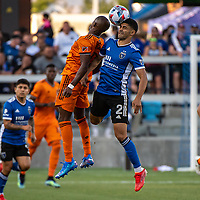 SAN JOSE, CA - JULY 24: Fafa Picault #10 of the Houston Dynamo heads the ball alongside Luciano Abecasis #2 of the San Jose Earthquakes during a game between San Jose Earthquakes and Houston Dynamo at PayPal Park on July 24, 2021 in San Jose, California.