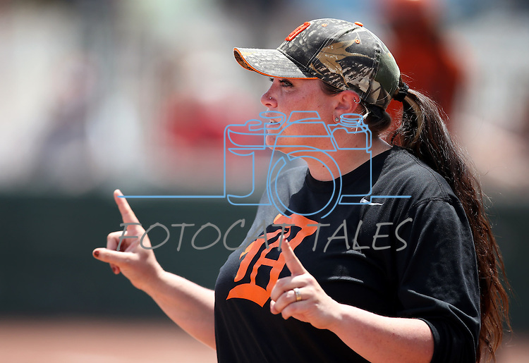 Douglas Tigers' Assistant Coach Kayla Jacobsen coaches a game against the Galena Grizzlies in a first round game of the NIAA northern region softball tournament in Reno, Nev., on Thursday, May 15, 2014. Galena won 5-4.<br /> Photo by Cathleen Allison