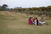 Agra, India.  Family Relaxing in the Mehtab Bagh Gardens, across the Yamuna River from the Taj Mahal.
