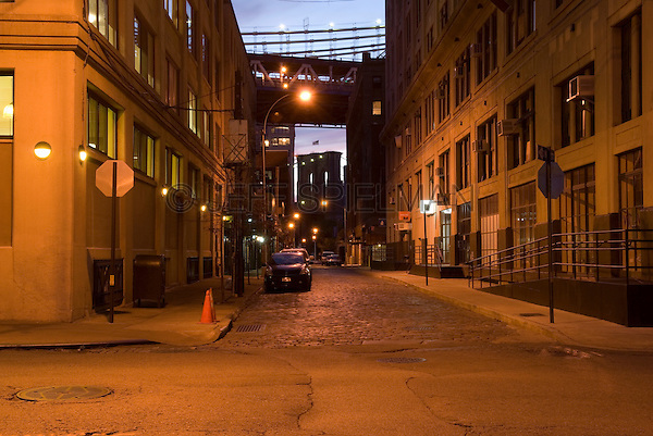 AVAILABLE FROM JEFF AS A FINE ART PRINT.<br /> <br /> AVAILABLE FROM JEFF FOR LICENSING.<br /> <br /> Mysterious Street Scene at Dusk with Brooklyn Bridge in the Background, The DUMBO Neighborhood of Brooklyn, New York City, New York State, USA