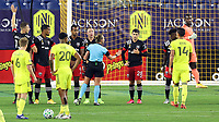 NASHVILLE, TN - SEPTEMBER 23: Referee Tori Penso cautions Joseph Mora #28 of DC United while pushing back the wall before a free kick during a game between D.C. United and Nashville SC at Nissan Stadium on September 23, 2020 in Nashville, Tennessee.