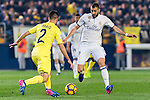 Karim Benzema of Real Madrid fights for the ball with  Mario Gaspar Pérez Martínez (l) of Villarreal CF during their La Liga match between Villarreal CF and Real Madrid at the Estadio de la Cerámica on 26 February 2017 in Villarreal, Spain. Photo by Maria Jose Segovia Carmona / Power Sport Images