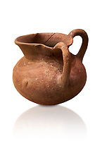 Hittite terra cotta two handled pitcher. Hittite Period, 1600 - 1200 BC.  Hattusa Boğazkale. Çorum Archaeological Museum, Corum, Turkey. Against a white bacground.