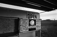 The only place in the US where four states (Arizona, Colorado, New Mexico, Utah) come together at the corners and touch.  Here shown is one of many concession stands surrounding the touristy, geographical spot. Displayed on the menu are items that are linked to the local Native American (Indian) population. Four Corners, USA November 2003 © Stephen Blake Farrington