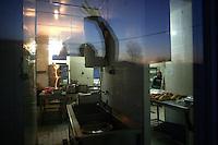 "SERBIA, Belgrade, Jan. 18, 2007..Chef walks in a shared kitchen in a refugee camp ""Krnjaca"" near Belgrade..© Djordje Jovanovic /EST&OST"