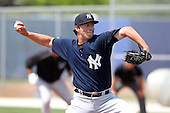 New York Yankees minor league player pitcher Adam Warren #72 delivers a pitch during a game vs the Toronto Blue Jays at the Englebert Minor League Complex in Dunedin, Florida;  March 21, 2011.  Photo By Mike Janes/Four Seam Images