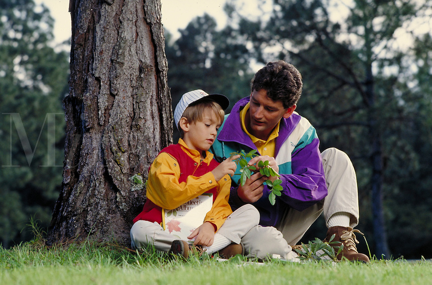 CAUCASIAN FATHER AND SON LOOKING AT PLANTS. FATHER AND SON. SAN FRANCISCO CALIFORNIA USA.