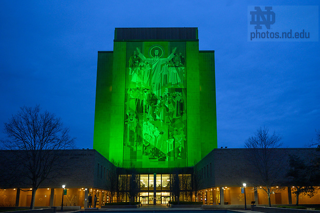 March 17, 2021; The Hesburgh Library Word of Life mural is lit green for St. Patrick's Day 2021. (Photo by Matt Cashore/University of Notre Dame)