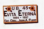 A plaque Evita Eternal hangs on a wall in Ciudad Evita; Evitas City, a pleasant suburb near the new international airport in Buenos Aires.