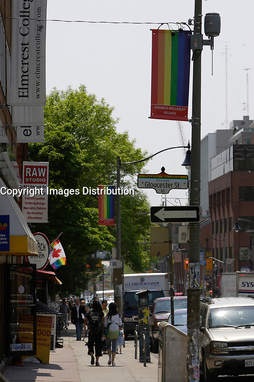 Church Street in The   Village ;  a predominantly gay neighbourhood in the heart of downtown Toronto.<br /> <br /> <br /> <br /> Home to Canada's largest gay community, Toronto welcomes gay and lesbian visitors with a full slate of entertaining things to see and do year-round. While Toronto is home to more than 4 million people, the gay and lesbian village is nestled in the downtown core, centered around the intersection of Church and Wellesley Streets. The area is packed with cafés, restaurants, gay-oriented shops and a vast array of bars and hot nightspots.<br /> <br /> Photo : Pierre Roussel - Images Distribution