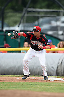 Batavia Muckdogs first baseman Eric Fisher (29) stretches for a throw during a game against the Mahoning Valley Scrappers on June 22, 2015 at Dwyer Stadium in Batavia, New York.  Mahoning Valley defeated Batavia 15-11.  (Mike Janes/Four Seam Images)