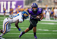 Uriel Espino (26) of Fayetteville runs ball against Jonathan Grayson (3) of North Little Rock at Harmon Field , AR, on Friday,September 10, 2021 / Special to NWADG David Beach
