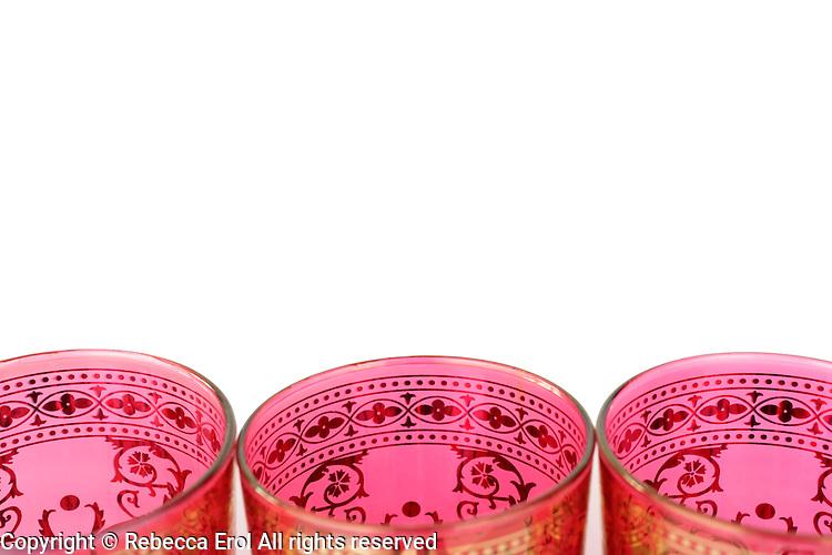 Moroccan tea glasses on a white background