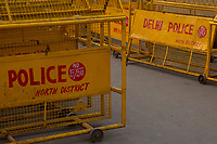 """Yellow police barriers marked """"Delhi Police"""" stand in piles outside the entrance of the Red Fort in Delhi, India, on Tue., Dec. 11, 2018."""