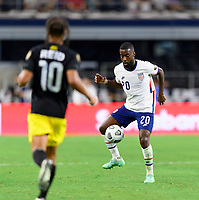 DALLAS, TX - JULY 25: Shaq Moore #20 of the United States gains control of a loose ball during a game between Jamaica and USMNT at AT&T Stadium on July 25, 2021 in Dallas, Texas.