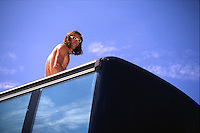 Rob Warner on roof of bus , Malverns event 1995 <br /> pic copyright Steve Behr / Stockfile