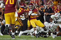 LOS ANGELES, CA - SEPTEMBER 11: Jimmy Wyrick #18 of the Stanford Cardinal tackles Keaontay Ingram #28 of the USC Trojans during a game between University of Southern California and Stanford Football at Los Angeles Memorial Coliseum on September 11, 2021 in Los Angeles, California.
