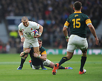 Mike Brown of England is tackled by Ruan Combrinck of South Africa during the Old Mutual Wealth Series match between England and South Africa at Twickenham Stadium on Saturday 12th November 2016 (Photo by Rob Munro)